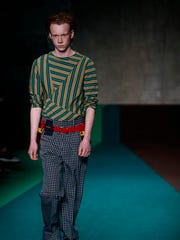 A model wears a creation for the Marni men's Fall-Winter 2017-2018 collection, part of the Milan Fashion Week, unveiled in Milan, Italy, Saturday, Jan. 14, 2017.