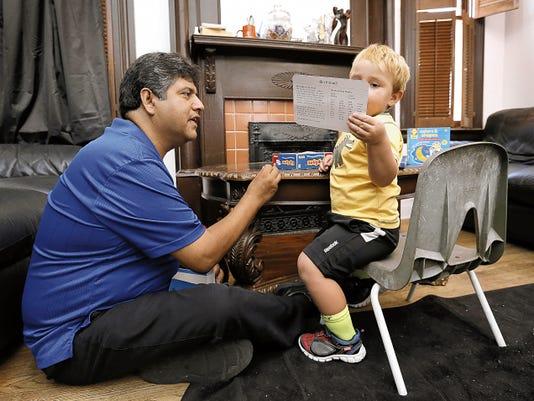 Therapist Luis Alvarez of the El Paso Del Norte Children's Development Center visits the home of 2-year-old Steve Villegas on Friday.