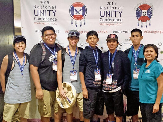 From left, Mathis Quintana, Eric Woody, Seneca Martin, Trevor Smith, Tristan Joe, Eurick Yazzie and Denise Joe, all members of the Navajo Prep Naat'áanii Youth Council, pose for a photo on Friday at 2015 National UNITY Conference on Friday in Washington, D.C. The group also attended the White House Tribal Youth Gathering on Thursday.