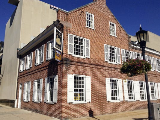 Known as the Golden Swan Tavern, the building at 2 E. Market St. dates to the early 1800s and was renovated in the 1980s for use as office space. It's on the market for 550,000. (Erin James photo)