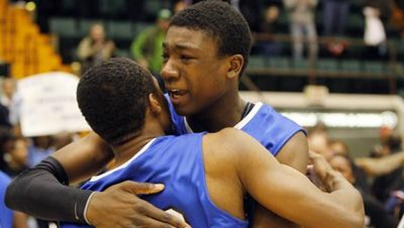 Thomas Bryant hugging a teammate after Bishop Kearney