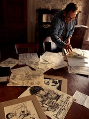 Artist Ed Epstein pictured Wednesday in Montpelier with some of the sketches he made while watching bands perform.
