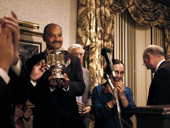 Cajundome director Greg Davis accepts the 2005 Civic