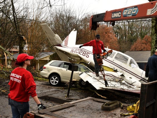 An aircraft recovery team from Clarksville and FAA investigators were on the scene Wednesday, Dec. 20, 2017 where a small plane which crashed yesterday on 