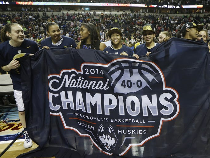 The Connecticut team celebrate their win over Notre Dame 79-58 after the second half of the championship game in the Final Four of the NCAA women's college basketball tournament, Tuesday, April 8, 2014, in Nashville, Tenn. (AP Photo/Mark Humphrey)