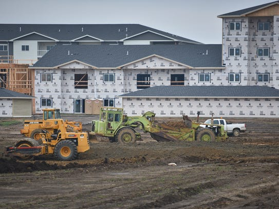 Construction takes place in front of Graystone Apartments,