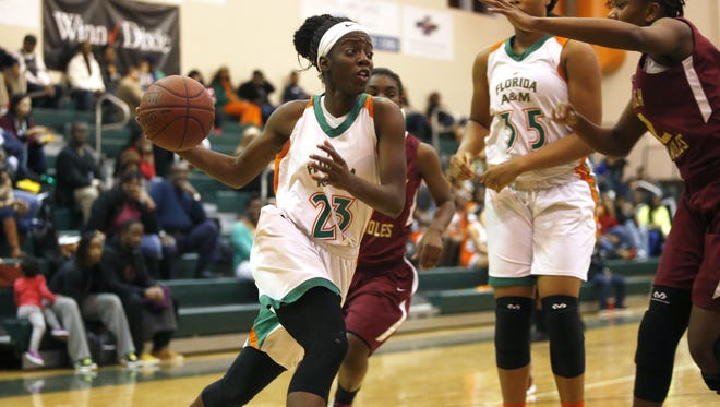 FAMU DRS senior Jazmine Jones drives to the hoop against Florida High during their game at FAMU DRS on Saturday. Jones had 27 points, 10 rebounds and seven assists in a 72-47 win.