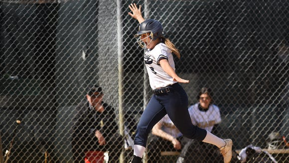 Paramus Catholic and Ramsey softball teams play during the HOFS Tournament in Saddle Brook on Saturday April 21, 2018. Ramsey's Kaitlin Houser has some fun as she makes her way home.