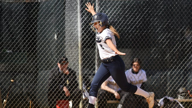 Paramus Catholic and Ramsey softball teams play during the HOFS Tournament in Saddle River on Saturday April 21, 2018. R#9 Kaitlin Houser has some fun as she makes her way home.