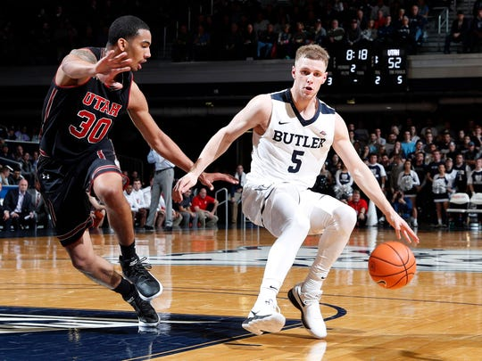 Dec 5, 2017; Indianapolis, IN, USA; Butler Bulldogs guard Paul Jorgensen (5) is guarded by Utah Utes forward Gabe Bealer (30) during the second half at Hinkle Fieldhouse.