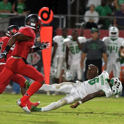 Fort Myers' Darrian Felix gets airborne during Friday