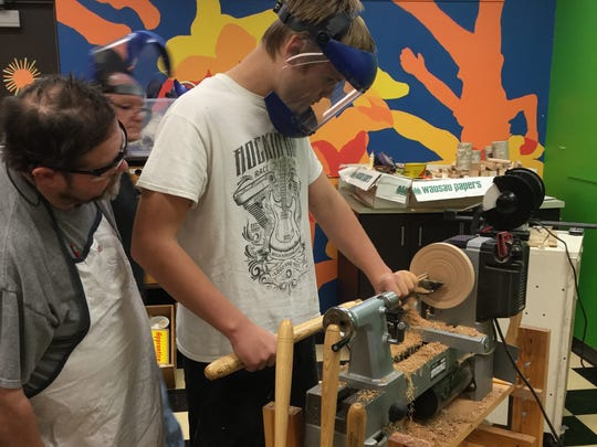 Wisconsin Valley Woodturners volunteers supervise students as they learn to turn wood.