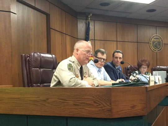 Cochise County Sheriff Mark Dannels, left, explains