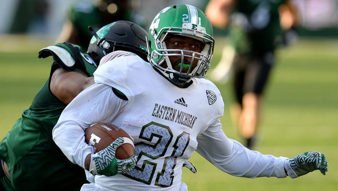Eastern Michigan wide receiver Antoine Porter keeps his eyes on the Charlotte defense in the first quarter on Saturday in Charlotte, N.C.