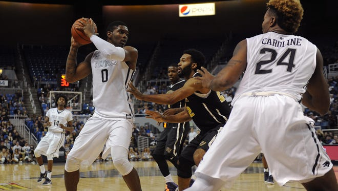 Nevada's Cameron Oliver surveys the defense in the Wolf Pack's win over San Francisco State.