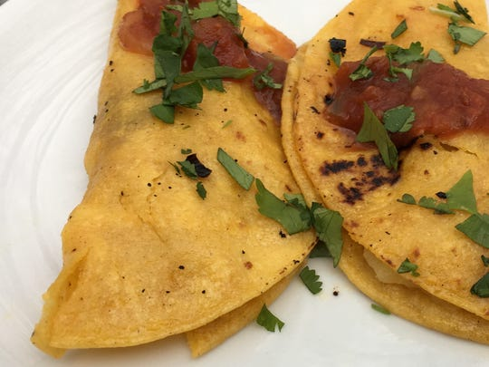 Unlike crunchy tacos, canasta tacos feature corn tortillas that are wrapped around fillings and then dipped into salsa. The packages are layered in a cooking vessel and steamed.