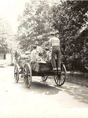 """Uncle Bill"" with a load of kids on Sunset Avenue in Clemson, around 1953."