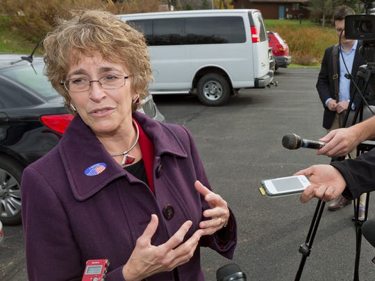 Martha Robertson talks to the media after voting at