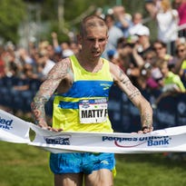 Matt Pelletier leads a pack of runners up Pearl Street during the People's United Bank Vermont City Marathon on Sunday. Pelletier won the VCM for the sixth time.