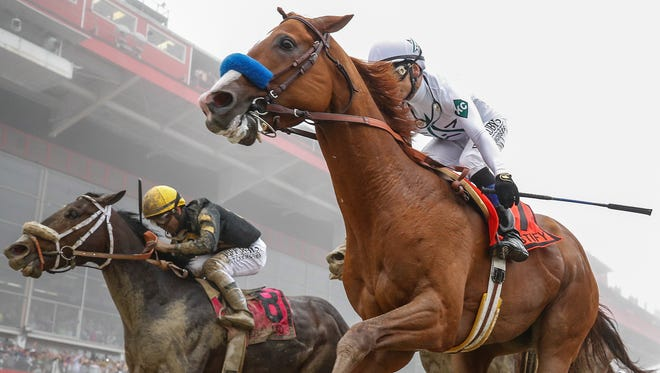 Justify wins the Preakness Stakes at Pimlico Race Course on  May 19 to capture the second leg of the Triple Crown.