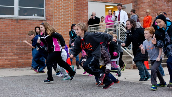 Kids take off from the starting line during the Turkey Trot Fun Run Tuesday at Gardens Elementary School in Marysville.