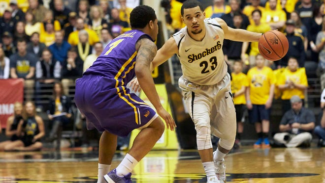 Wichita State Shockers guard Fred VanVleet (23) drives against Northern Iowa Panthers guard Deon Mitchell (1) at Charles Koch Arena.