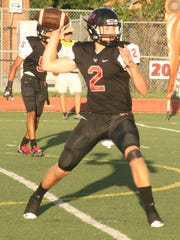 Getting set to throw a pass during the 2016 season for Livonia Churchill is quarterback Evan Cummins.
