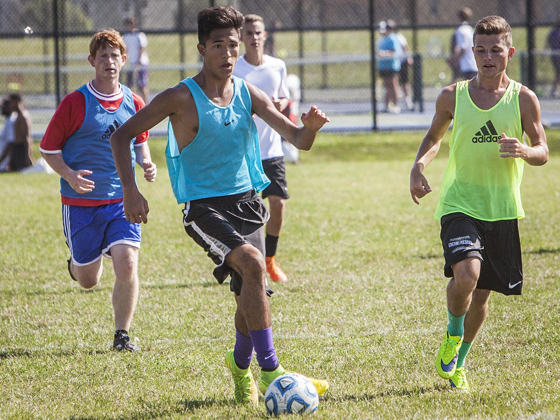 Central's Chase Clasby dribbles the ball in practice.