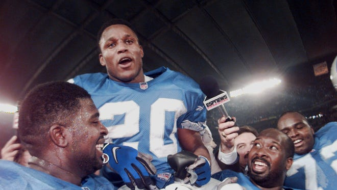 Detroit Lions running back Barry Sanders gets a ride on the shoulders of offensive linemen Kevin Glover, right, and Ray Roberts on Dec. 21, 1997 at the Pontiac Silverdome. Sanders celebrates his 2,053-yard rushing season.