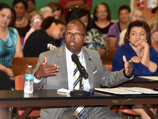 Newly appointed St. Landry Parish School Board Superintendent Patrick Jenkins answers questions from board members Wednesday.