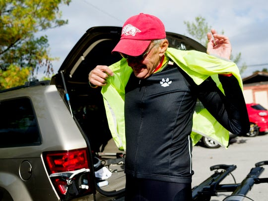 Doug Jerger puts on a neon vest to be more visible on the road during a group bike ride in Maryville, Tennessee, on Tuesday, November 14, 2017. Knoxville Regional Transportation Planning Organization created a map of all walker/biker accidents with cars and found that Alcoa has the most per capita.