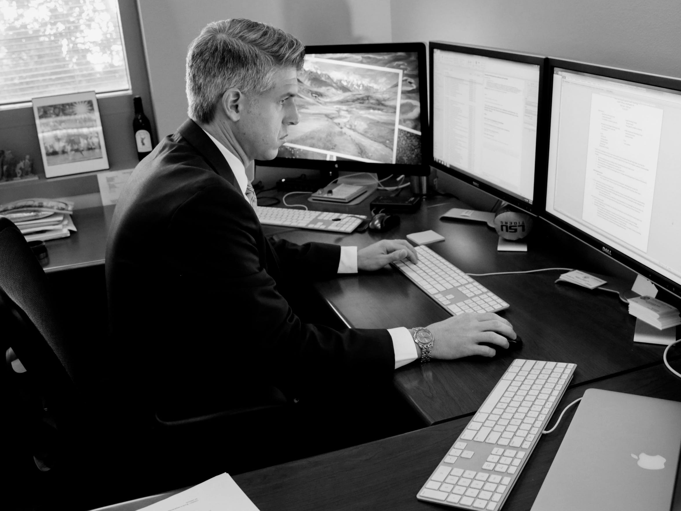 Lab Supervisor Corey Bourgeois at the Attorney General's Cyber Crime Lab.  Bourgeois and his staff use forensic examinations of devices to recover deleted data.