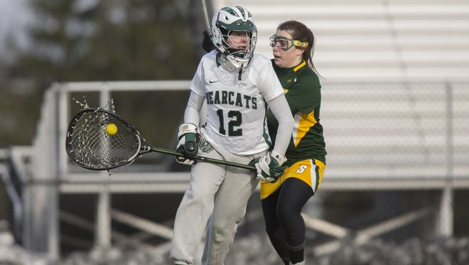 Binghamton University goalie Erin McNulty eludes a Siena attacker during a game during the 2013 season.