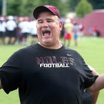 FSU defensive line coach Sal Sunseri yells encouragement during Wednesday drills. Hundreds of young football players were busy at the Florida State football complex being taught the Seminole way of playing during this year's edition of the Jimbo Fisher Football Camp.