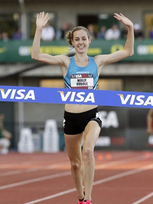 Molly Huddle hits the tape to win the 5,000-meter race during the U.S. track and field championships in Eugene, Ore., in 2011.