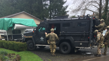 Oregon State Police's SWAT unit responds to call of a man threatening to kill his wife on the 18000 block of Wheatland Road in rural Salem on Friday, March 24, 2017.  Ricky Shawn Nelson, 50, refused to surrender to law enforcement for roughly four hours.