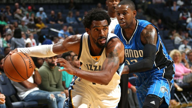 October 3, 2016 -  Memphis Grizzlies Mike Conley makes a strong move to the basket defended by Orlando Magic's C.J. Watson during a preseason game at FedExForum.  (Nikki Boertman/The Commercial Appeal)