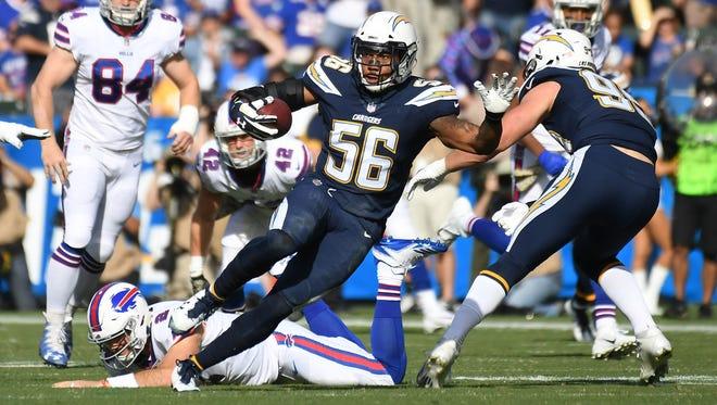 Nov 19, 2017; Carson, CA, USA; Los Angeles Chargers inside linebacker Korey Toomer (56) returns an interception past Buffalo Bills quarterback Nathan Peterman (2) for a touchdown in the first half of a NFL game at StubHub Center. Mandatory Credit: Richard Mackson-USA TODAY Sports