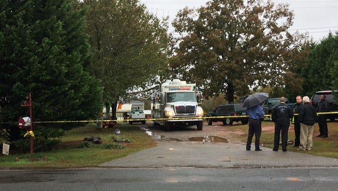 Investigators on a scene on Refuge road in Pendleton
