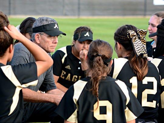 Abilene High softball coach Jim Reese talks to his
