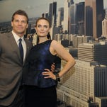 """David Boreanaz, left, and Emily Deschanel, co-stars of the FOX television series """"Bones,"""" pose together after the Los Angeles City Council held a proclamation ceremony for the show at John Ferraro Council Chamber on Friday, Nov. 9, 2012, in Los Angeles. The City Council recognized the show in general and specifically the upcoming episode """"The Patriot in Purgatory,"""" which calls attention to issues facing American military personnel once they return from service. (Photo by Chris Pizzello/Invision/AP)"""