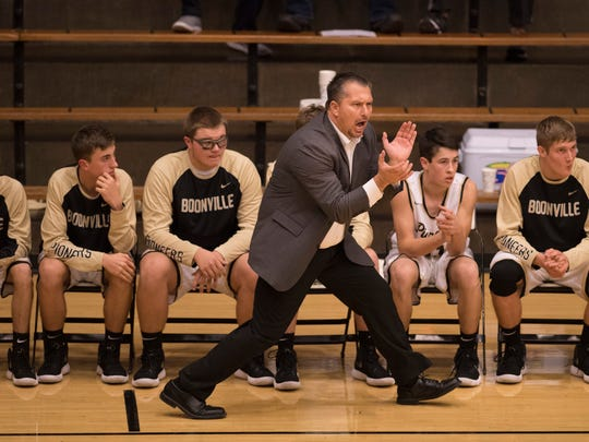 Boonville head coach Brian Schoonover prowls the sideline against Castle at Boonville High School Tuesday night. The Knights beat the Pioneers 77-60.