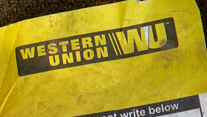 This is a photo illustration of a Western Union money transfer receipt.