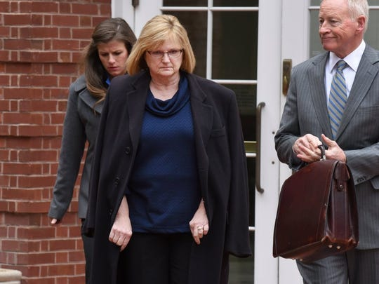 Former Pilot Flying J employee Vicki Borden, center, who supervised various sales support staff, leaves federal court after being arraigned Tuesday on charges including conspiracy to commit wire fraud and mail fraud. Seven other Pilot employees were also named in the 14-count indictment. (MICHAEL PATRICK/NEWS SENTINEL)