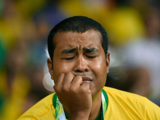 A fan of Brazil reacts during the semifinal match between Brazil and Germany at The Mineirao Stadium in Belo Horizonte during the 2014 FIFA World Cup on July 8, 2014.