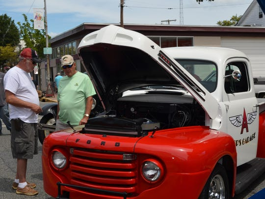 Paul Schwegel and Bill Hunter, both of Millville, talk about cars at the 25th Annual Downtown Millville Car Show.