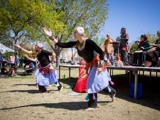 The New World Drummers and Dancers group performs during the Las Cruces International Festival at Pioneer Women's Park, April 2, 2016.