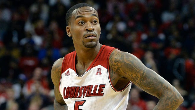 Louisville's Kevin Ware looks to the bench during the second half of their NCAA college basketball game Nov. 29, 2013, in Louisville, Ky.