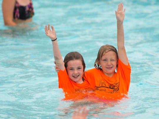 Children from Camp Wallace in Knoxville find their