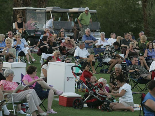 Palm Desert residents enjoy the United States Navy Band Southwest perform at the Palm Desert's free Summer Concerts in the Park series at the Palm Desert Civic Center Park amphitheater, Thursday, June 9, 2011. (Richard Lui The Desert Sun)